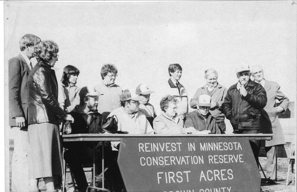 1986: The Brown County RIM First Acres Ceremony was held at the Runck Dairy Farm. State Legislators Dennis Frederickson and Terry Dempsey, DNR Commissioner Joe Alexander, and MN Secretary of Ag Jim Nichols celebrated with local officials and landowners. Ward Sinclair, writer for the Washington Post, also visited the site.