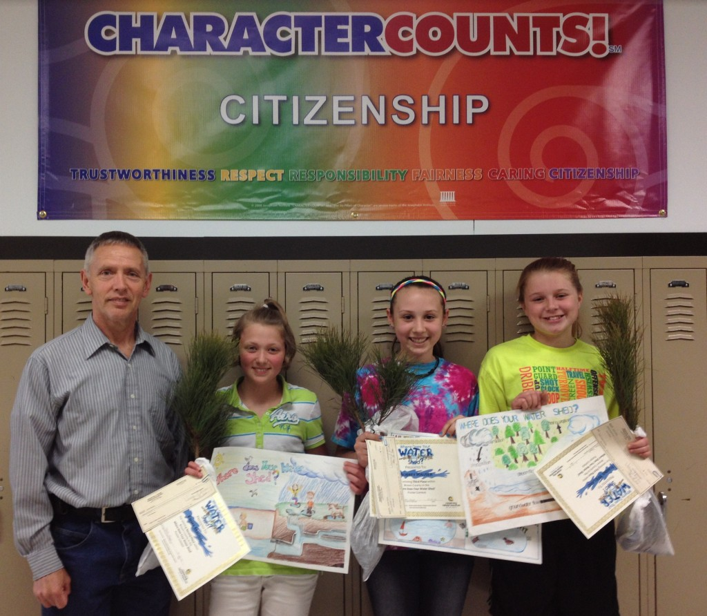 Mr. Ellingson with students Emma Maudal, Aubrey Hauser, and Iyanna Wieland.